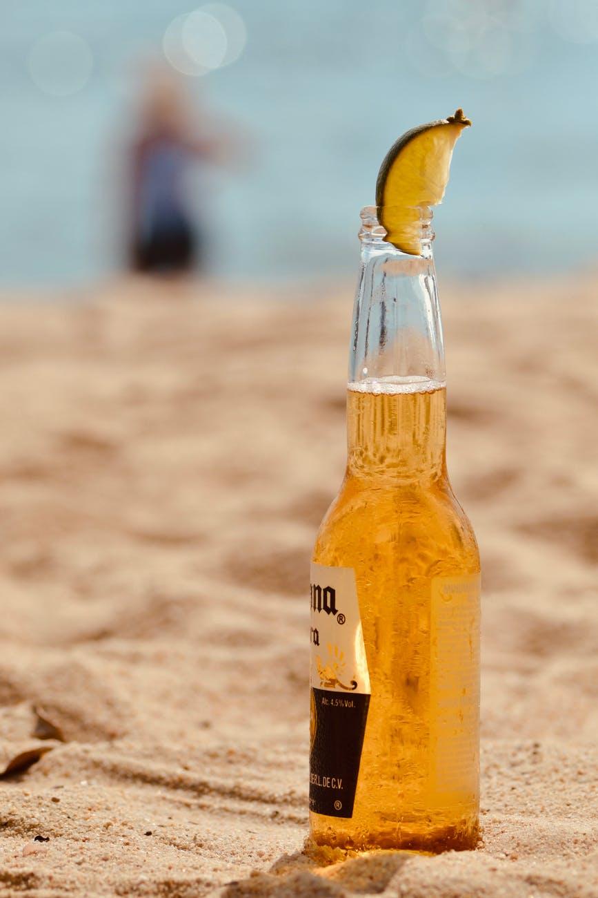 corona beer bottle across sands