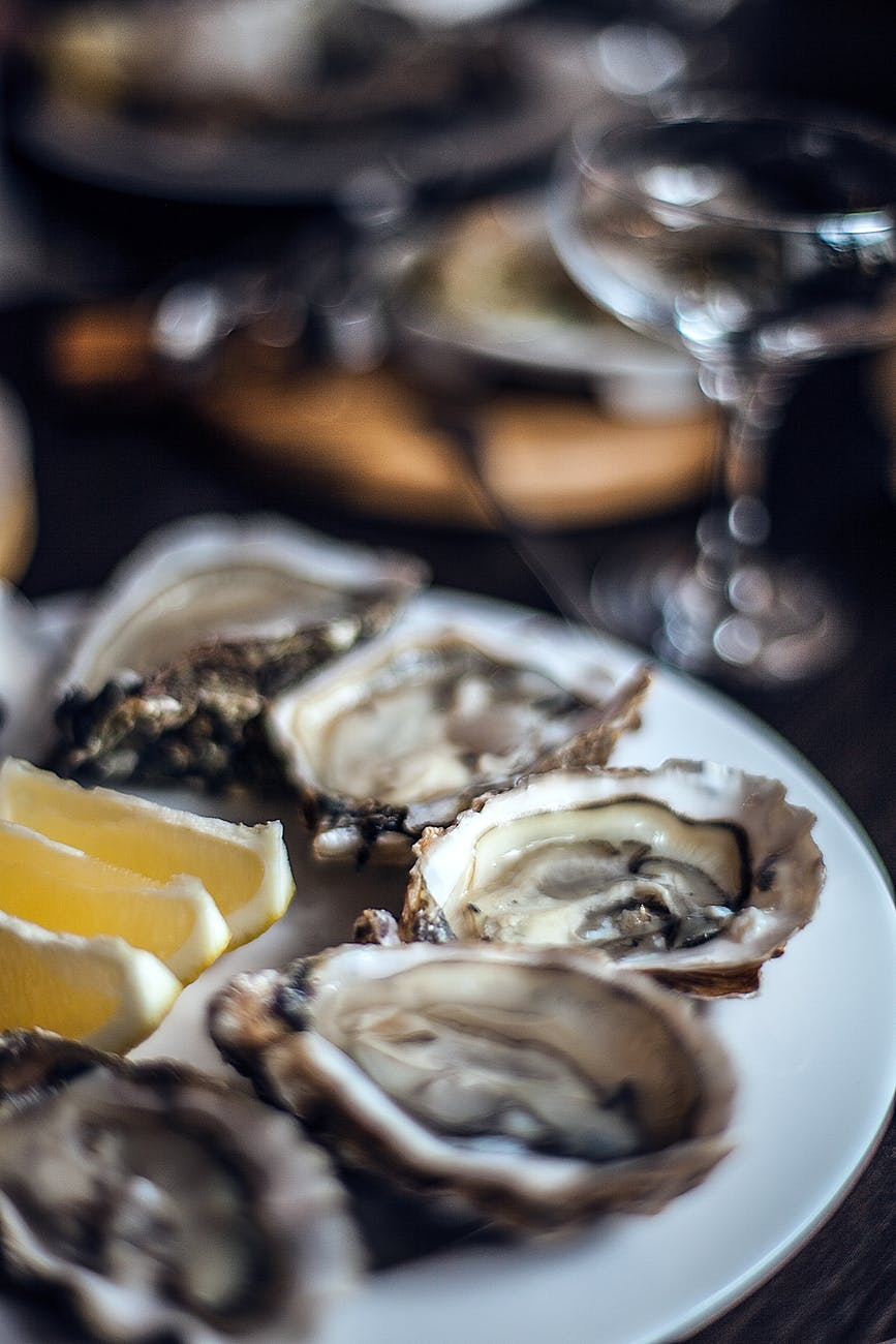 delicious oysters with lemon served in fancy restaurant