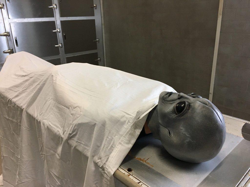 Alien being autopsied.