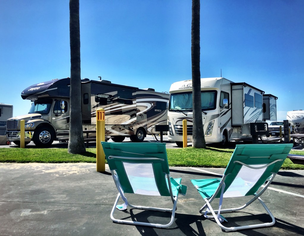 RV park with two chairs set up.