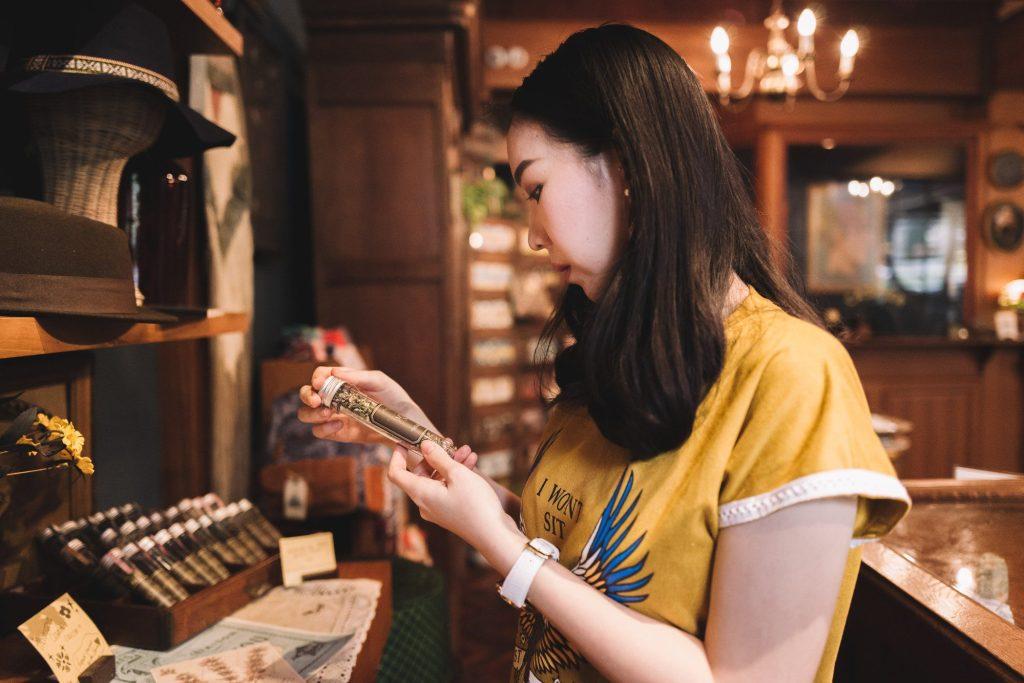 Woman shopping in antique shop.