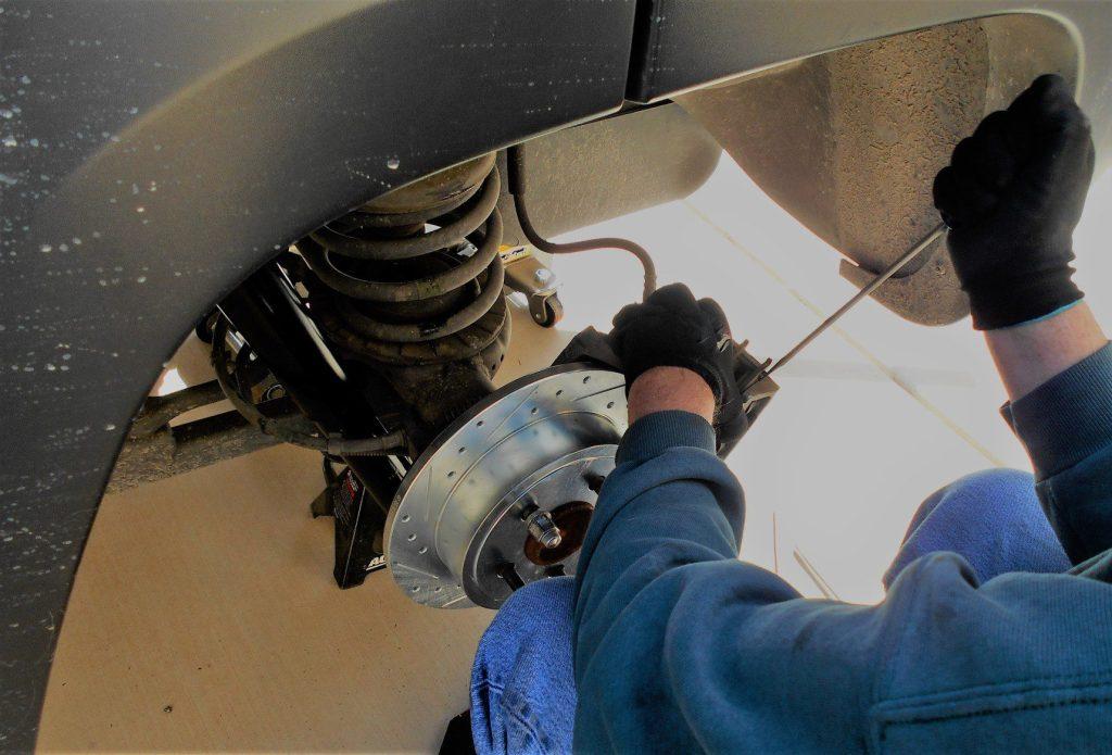 Man installing brake.