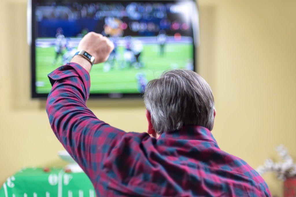 Man cheering at a football game.