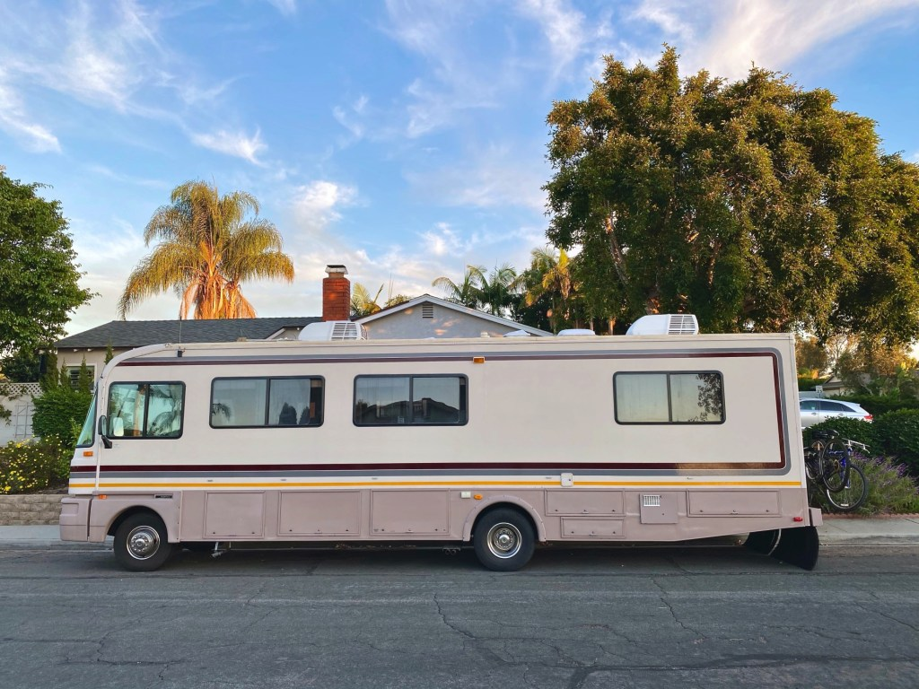 RV parked in front of house.