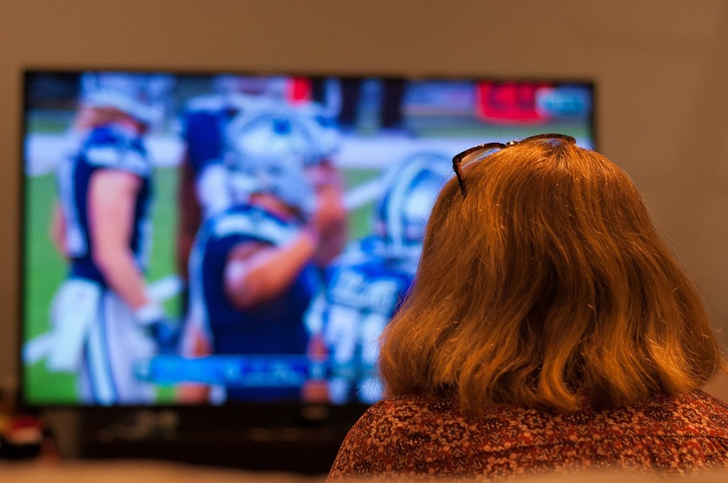 Woman watching college football.