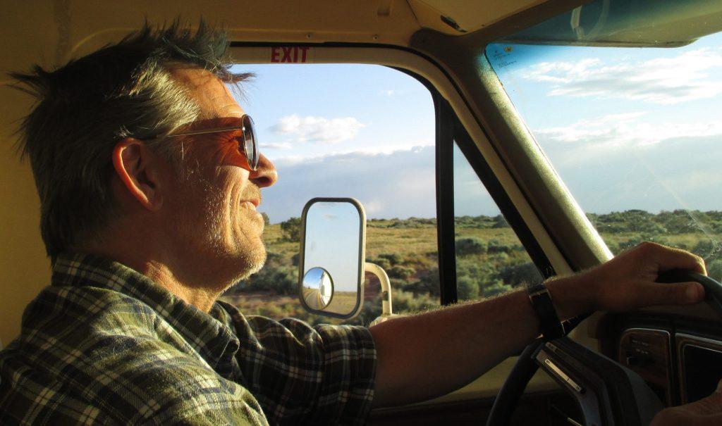 Man happily driving RV.