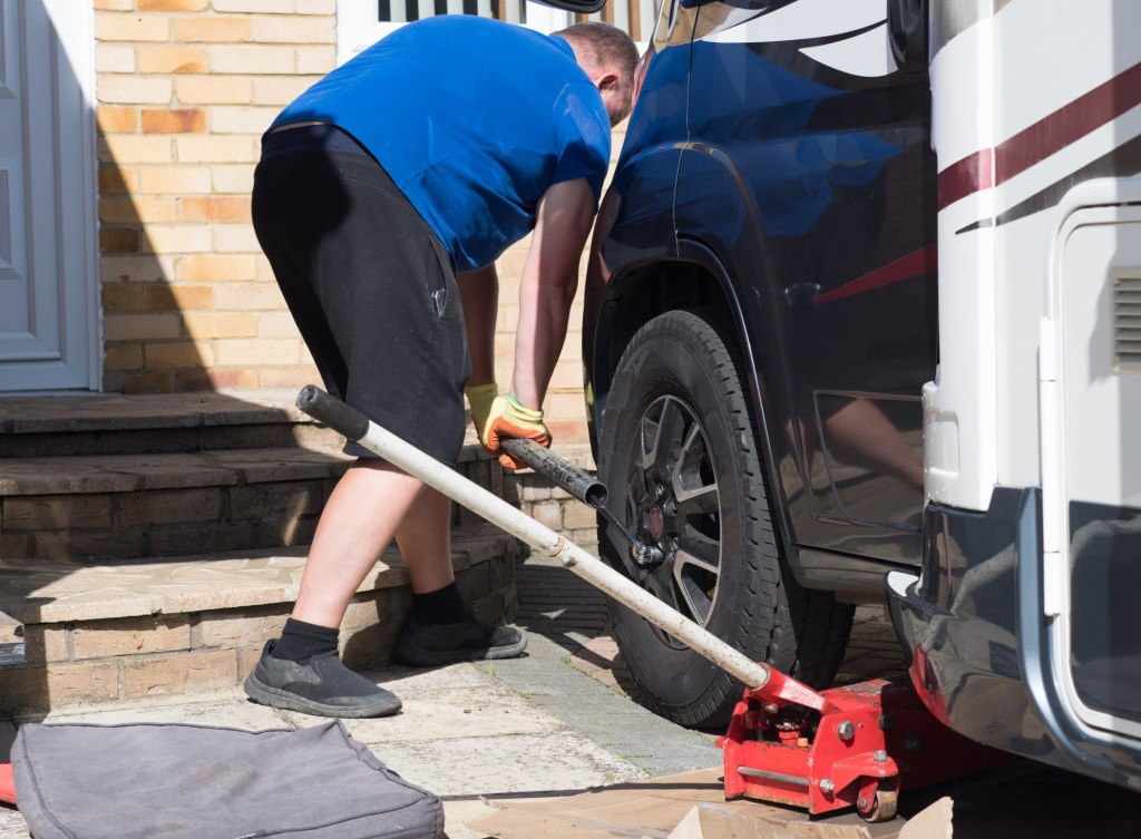Man repairing RV tire.