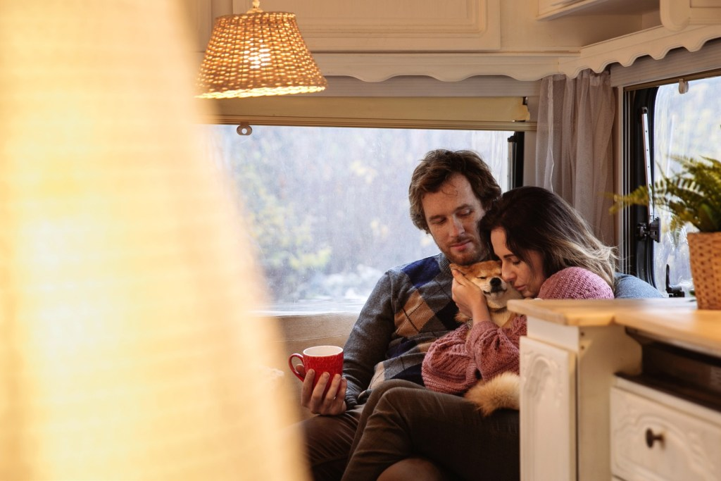 Couple in RV with dog.